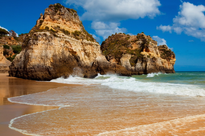 Praia Tres Irmaos in Algarve, Portugal with huge rocks on the beach.